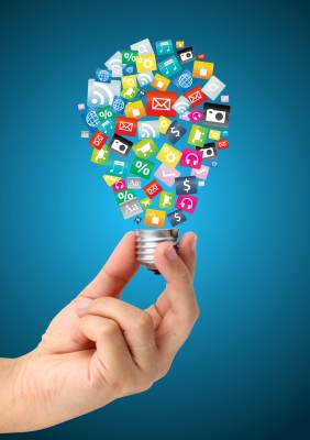 Creative Light Bulb Idea In Hand With Cloud Of Colorful Application Icon