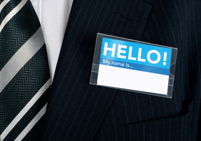 Namebadge saying hello on a well dressed businessman - insert your own information