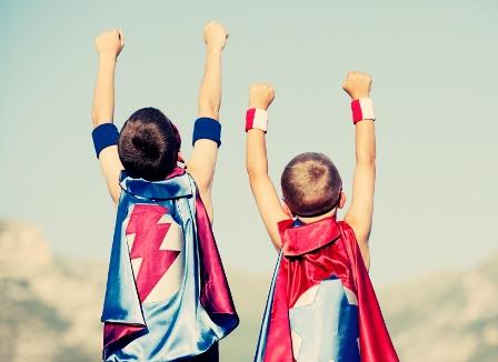 kids raising hands to the sky